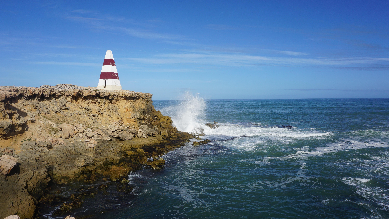 Crashing waves and blue skies
